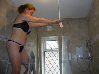 WHAT SHOWER RAIL? ALL I SEE IS A GORGEOUS LADY IN A BRA AND BIKINI PANTY.....