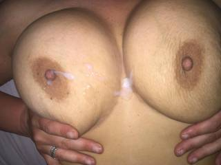 Shot my hot load over her tits, she loves it. ;)