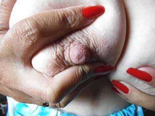 Wanna give my nipple a little nibble?