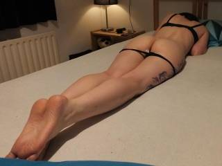 Shy girlfriend showing her ass and feet. Imagine finding this on your bed, what would you do? :-)