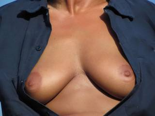 Love your beautiful tits, big aerola (my favorite!) and deliciously hard nipples begging to be sucked!!