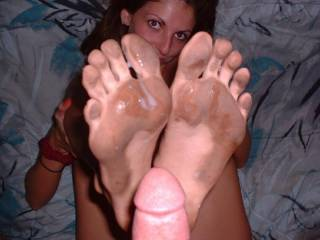 mmm i would love to be in thisphoto kissing her beautiful dirty feet,sucking her toes,that nice cock and hottcum off her feeet:)