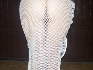 Love to slide the hem of your sexy mesh dress up until it frames your sweet ass and then stroke my cock and cum all over you.