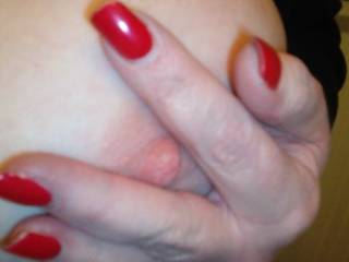 Cindy shows us some of her sweet, pink nipple! Don\'t you love that red fingernail polish?