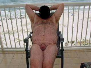 Hubby posing in the nude at our condo while on our summer 2008 beach vacation.  We had an audience in the form of the condo maid for this pic!
