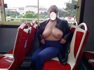Flashing her beautiful tits on tour bus