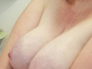 Big milk filled breasts in the shower