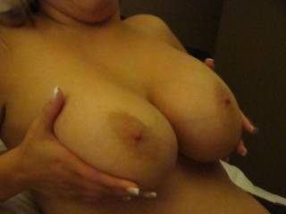 Wow!  Your tits are absolutely perfect...shape, size, hard nipples and big aerola (my favorite)!!  Plus I love the nails that you can dig into me while I make you cum over and over!!
