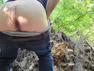 Showing my ass in front of the stump of a huge fallen tree in the woods. Need your wood buried in me...