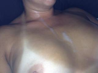 Now that's hot, nice hot sexy tits cover in cum, nice, only thing nicer would be me adding another load all over them and that pretty face