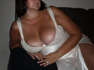 Your hubby's cock had to be ripping thru his pants when he saw your 44D tits in this outfit. Seeing all that cleavage, and your thighs from that slit would have my cock ripping thru my pants too. What would you do with 2 hard cocks?