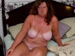 wife posing on bed