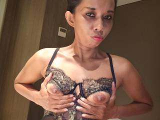 Tyara in Jakarta, showing her small tits....