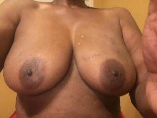 Some beautiful black tits I am going to shoot cumm all over tonight, any ladies want to suck on these for me lick the cumm off