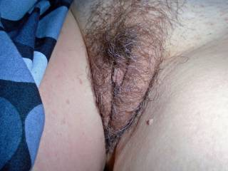 Wifes hairy pussy with her clit showing,