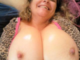 "Just squeezing my big oiled boobs together for you "")"