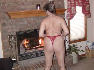 Sexy wife getting cozy by the fire.