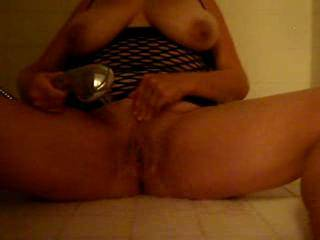 Late night all alone....wanting my husband.  I decided to go into the shower (my favorite place to masturbate) and use the shower head to make myself cum.  It felt soooooooo good.  I wish he was here, but I did the next best thing.