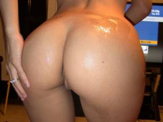 That is one AWESOME ass and HOT body!!  Could sure enjoy oiling you up and playing with those sweet lips and holes!!