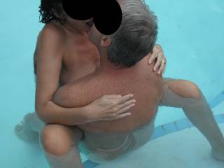 Playing with our swinger friend in the swimming pool at home, when he came around for a threesome.