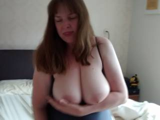 My wife loves playing with her tits, squeezing and pulling her nipples.