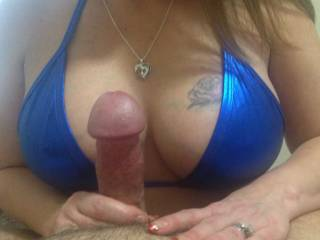 Never tire of watching her play with my cock while watching those great tits !