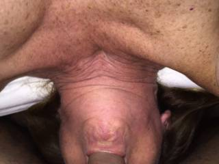 Wife sucking cock hanging over edge of bed