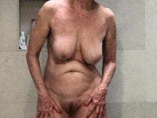 Caught my sexy wife in the shower again. I really like her new hair style.