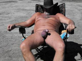 getting hard in the sun ready to display my hardening cock to the horny couple nearby