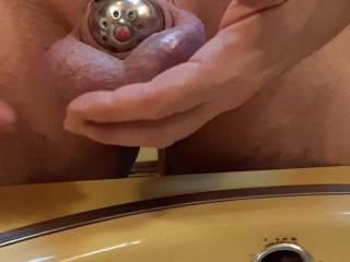 Amy put me in the most restrictive chastity cage yet... so tight and confining.  At least the hole lines up well enough to allow me to p!ss... and hopefully cum.  Not being able to get even the slightest bit erect, I have an idea how to get off... watch.