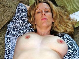 Beautiful breasts and sexy nipples.  I enjoy playing with such things.  Did I tell you that you remind me of Jamie Lee Curtis?  She is a beautiful woman too.  I've had the hot's for her for years.  G