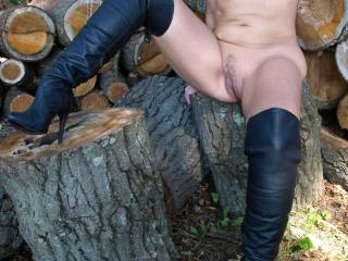 Hubby caught me dressing like a naughty girl and made me go to the woodpile. He said I needed to be taught a lesson and made me take the dress off. After giving me a good lickin\',  he took out a big stick and thrust it upon me.