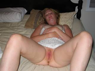 I want to bury my face in her warm damp pussy and kiss, lick, nibble, suck, and tongue fuck her sweet pussy until her thigh are shaking and she is begging for a cock to be shoved into one of her holes. Which on would she want my cock in?