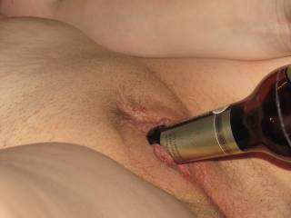 love to have my cock replace that bottle, or lick you after you remove the bottle, your choice