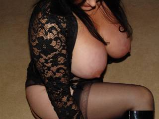 Seeing your beautiful tits hanging out like that just looks amazing.  Love the sexy top and hot stockings too. Great pic.