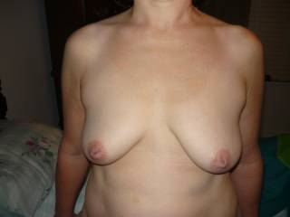 I would love to lick them and tease them with my tongue to make them get hard...  Then I would suck on them to make them pop out.  Gorgeous breasts...  Incredible nipples!