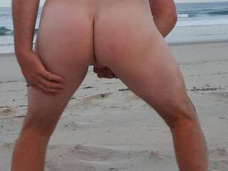 Showing off my smooth ass at the nude beach anybody like the brush the sand of it for me.