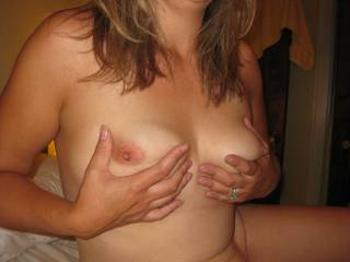 Mnwife holding her beautiful tits