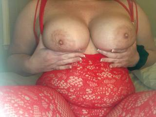 Another tit pic in her red bodysuit...