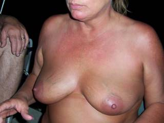 sexy completely naked with the guys on the boat!!!   what beautiful tits she has!!!