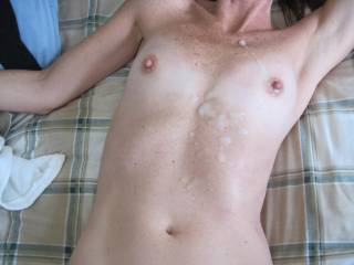 I had to unload on her tits. We would love to have a female lick her clean!