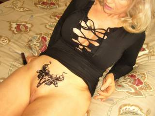 Showing my tattoo...in iy little black dress with no panties...