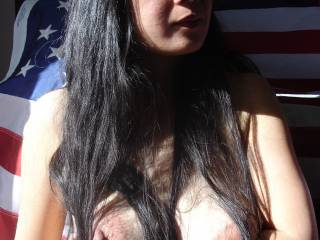 Chinese GF while in America Flashes her huge tits for me to et my hard - it worked! I fucked her until I was raw after that.