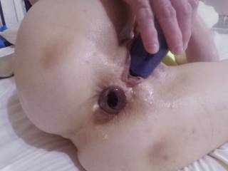 With this crystal bottle stopper stuffed in my ass and the multi-vibe buzzing my clit, I have a good head start on my neighbor. Bet I cum before you do!