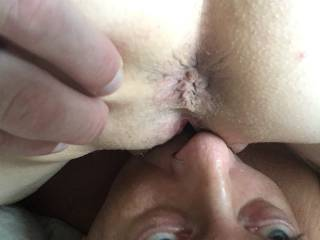 A close up of her ass as she grinds my face. Would you like to fuck her ass as I lick her pushy?