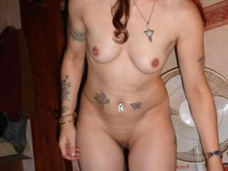Great body and very sexy tattoos on this hottie...not to mention those nice supple tits and her gorgeous pussy.