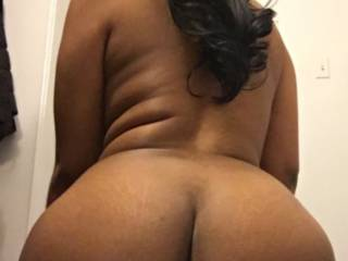 Tell me what you wanna put between these big round brown ass cheeks! Btw look how fat my pussy looks it's hanging down like I have a pair of balls lolol