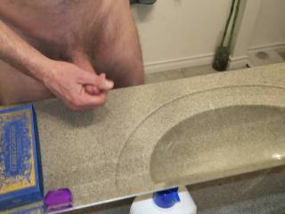 Jerking off. Was going to cum on the counter but changed my mind and shot a load on the floor.