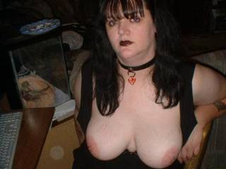 Well hello there, great tits...  Love the fishnets too...