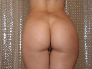 What a gorgeous ass.  Mmmmm, I also see that sweet pussy, nice.  Sweetie it would be hard to spank that perfect ass,(it would be hard even if I didn't) but (no pun intended) I would spank you as requested for being a naughty girl.  May I rub and fondle that beautiful ass first?  After I spank your sweet ass, will you spank my monkey?  G
